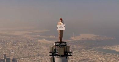A Woman stands on top of Burj Khalifa